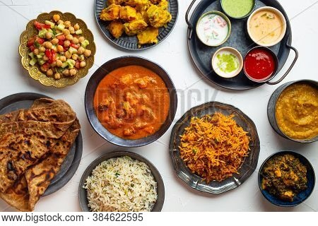 Variety Of Indian Food, Different Dishes And Snacks On White Rustic Background. Pilaf, Butter Chicke