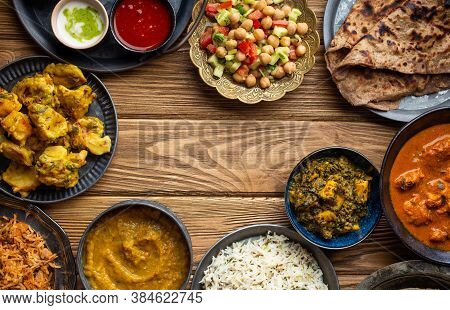 Assorted Indian Home Food, Different Dishes And Snacks, Wooden Rustic Table. Homemade Pilaf, Butter