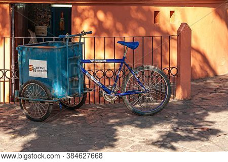 Leon, Nicaragua - November 27, 2008: Blue Garbage Collection Tricycle Parked In Front Of Orange And