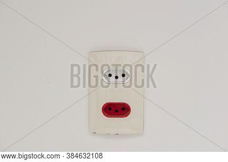 Close Up Shot Of A White Wall Plug With A Swiss And Brazilian Standard Socket. 3-pin Socket. White S