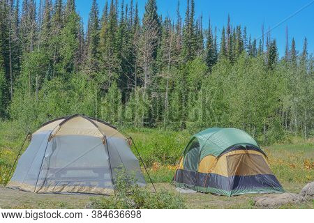 Campsite With Tents In Freeman Reservoir Campground. In The Routt National Forest Of The Rocky Mount