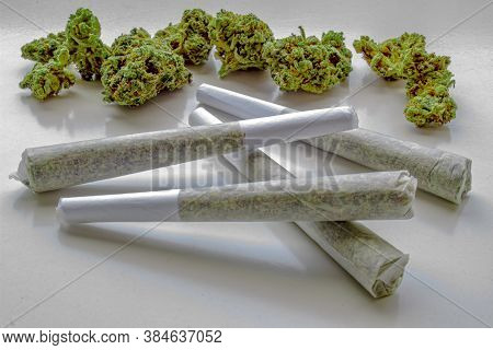 Several Pre-rolls Of Medicinal Cannabis With Flower Cannabis On The Background