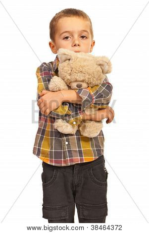 Sad Kid Hugging Teddy