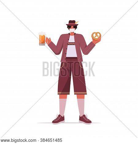 Man In Medical Mask Holding Salty Pretzel And Beer Mug Oktoberfest Party Celebration Coronavirus Qua