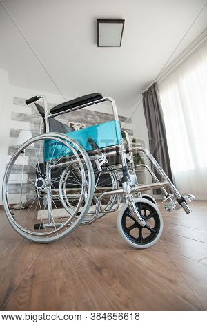 Wheelchair In A Room With Nobody In It For Patients With Walking Disability. No Patient In The Room
