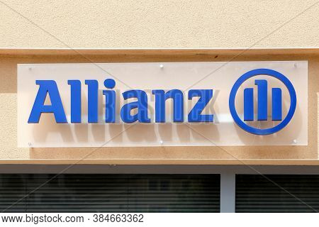 Tarare, France - June 27, 2020: Allianz sign on a wall. Allianz is a European financial services company headquartered in Munich, Germany