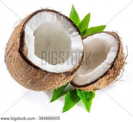 Cracked coconut fruit with white flesh isolated on white background.