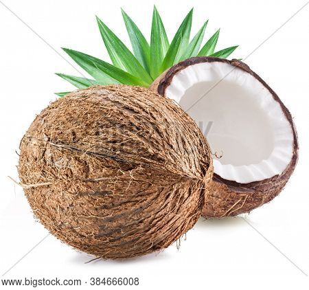 Cracked coconut fruit with white flesh and a whole coconut isolated on white background.