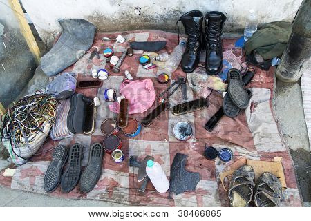 Shoe shiners workplace in an indian street