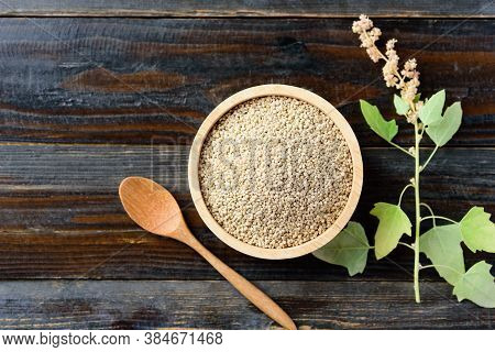 Raw Brown Quinoa Seed (chenopodium Quinoa) In A Bowl With Spoon On Wooden Background, Healthy Food,