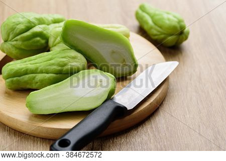 Chayote Squash Or Mirlition Squash On Wooden Board Preparing For Cooking