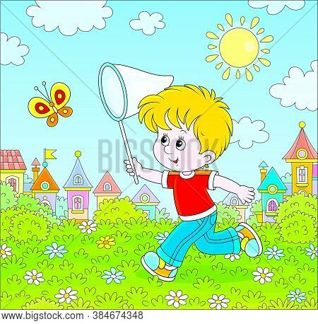 Little Boy Running And Catching A Flying Butterfly With A Butterfly Net Among Flowers On Green Grass