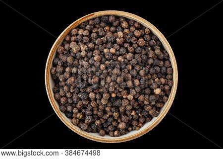Psd Top View On Black Peppercorns In A Bowl Isolated On Black Background