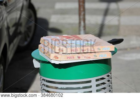 Nice, France - January 29, 2019: Empty Pizza Boxes On A Trash Can In The Street In Nice On The Frenc