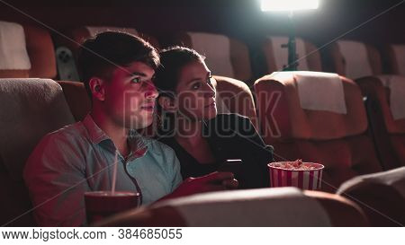 Men Playing Games On Mobile Phones He Makes His Girlfriend Annoy And Interfere With Watching The Mov