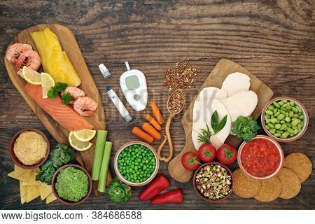 Low glycemic testing & lancing devices with health food for diabetics below 55 on the GI index. High in antioxidants,  vitamins, minerals, fibre, protein, omega 3 & smart carbs. Healthcare concept.