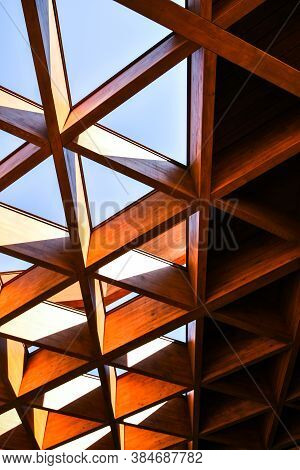 Roofing Construction. Wooden Roof Frame House Construction. Abstract Structure Background. Wood Text