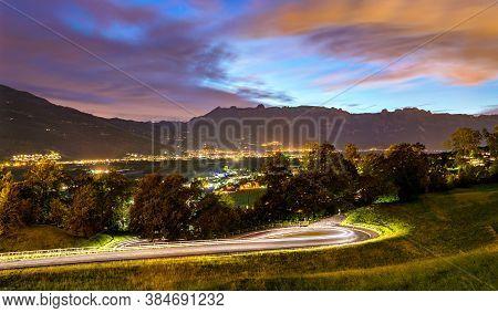 Curvy Road Towards Vaduz In Liechtenstein At Night