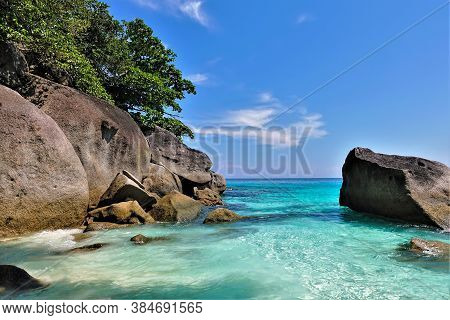 Thailand. Sunny Day. Amazing Andaman Sea, Clear Aquamarine Water. Large Picturesque Boulders And Tre
