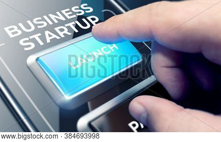 Finger About To Press A Glass Button With The Word Business Startup . New Business Concept