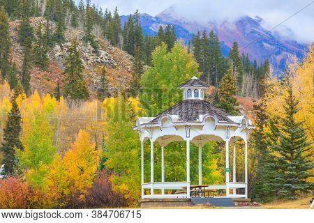 summerhouse in mountains in the autumn season