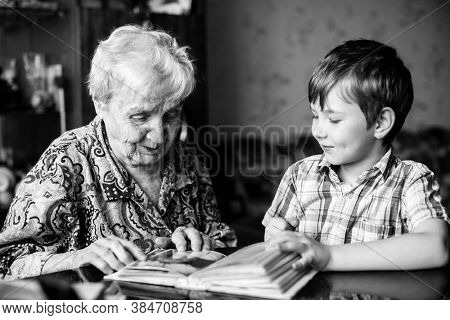 An old woman and grandson. Black and white photography.