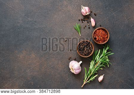 Spices, Chili And Fresh Rosemary On A Concrete Background.