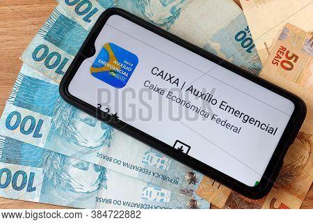 Rio De Janeiro, Brazil - September 5, 2020: Emergency Aid (auxílio Emergencial) Logo On The Smartpho