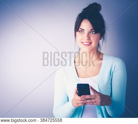 Woman Using And Reading A Smart Phone