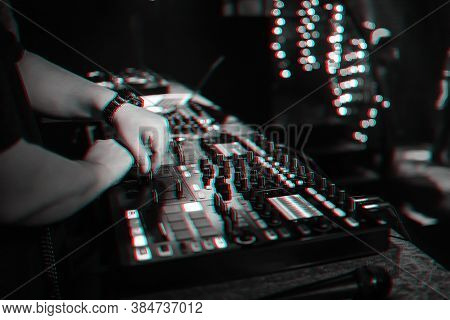 Male Dj Mixes Electronic Music On A Professional Music Controller