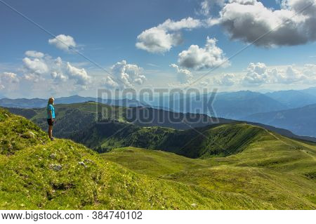 Active Girl Having A Rest On The Peak Of Alps, Austria, Europe.backpacker Enjoying View Of Mountain