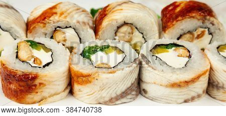 Sushi Roll With Eel And Chuka Salad On A White Plate, Classic Japanese Sushi. Traditional Japanese F