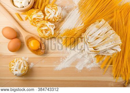 Raw Yellow Italian Pasta Pappardelle, Fettuccine Or Tagliatelle