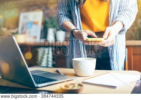 Woman Hands Taking Photo Of Coffee Cup, Green Leaves And Breakfast At Home In Brown Kitchen At Smart