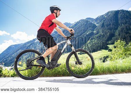 Man Riding Electric Mountain Bike Or E Bike In Alps