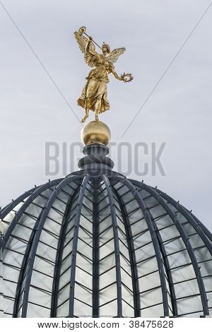 Golden Statue With Trumpet