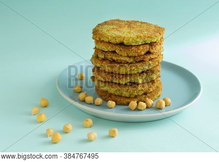 A Stack Of Veggie Burgers With Chickpeas And Vegetables On A Blue Background. Vegetarian Food Concep