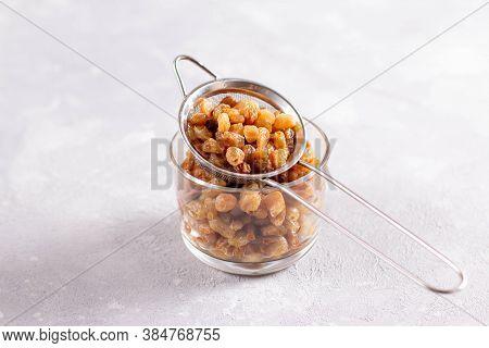 Natural Organic Dried Grapes Raisins. Prepare The Dough. Raisins In A Colander Or Sieve