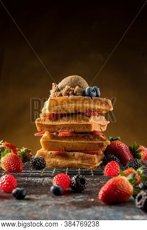 Waffles With Ice Cream, Caramel Sauce And Fresh Berries. Delicious Waffle With Berry And Ice Cream A