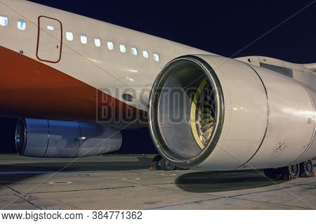 Close-up Passenger Aircraft Engines And Fuselage In The Night