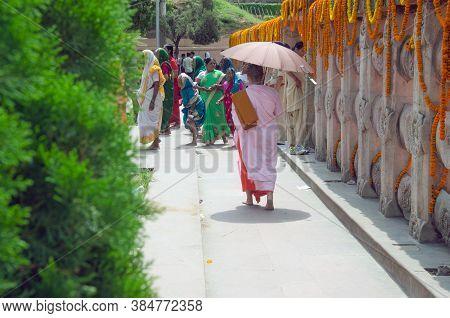 Bodh Gaya Bihar India April 30th 2018:during The Buddha Purnima, A Cambodian Lady Monk Walks To The