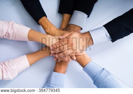 Business People Team Spirit And Employee Huddle