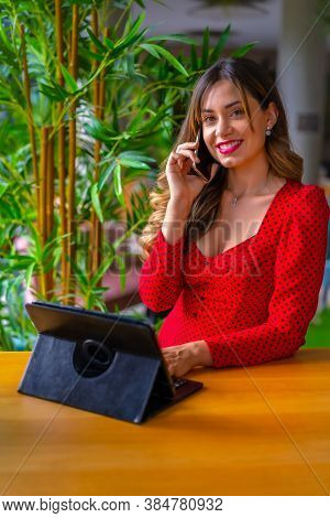 Young Blonde Caucasian Entrepreneur Conducting A Work Video Call From A City Hotel With A Tablet, Re