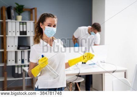 Workplace Cleaning Service Janitor Standing In Office Wearing Face Mask