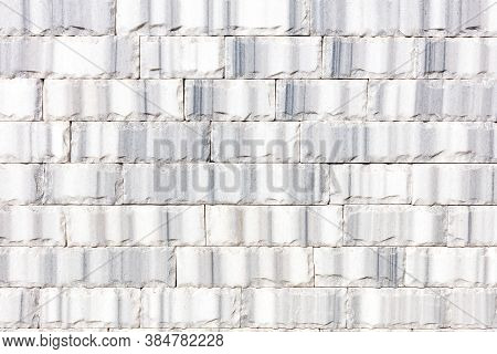 Wall Background And Texture Of Gray Marble Tiles Chipped Around The Perimeter, Close-up.