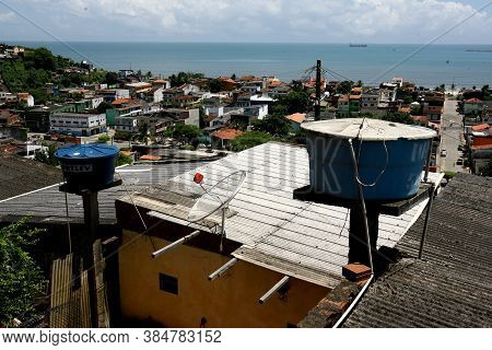 Ilheus, Bahia / Brazil - December 5, 2011: Water Tank Is Seen And Residence Of Favela In The City Of