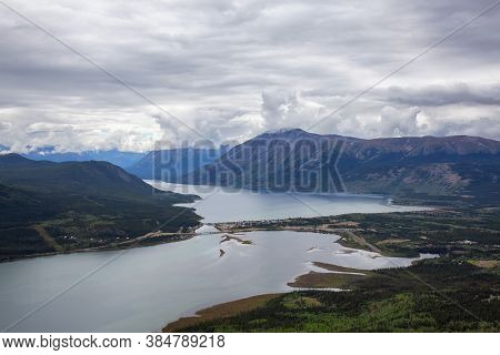 Beautiful View Of A Small Touristic Town, Carcross, Surounded By Canadian Mountain Landscape. Locate