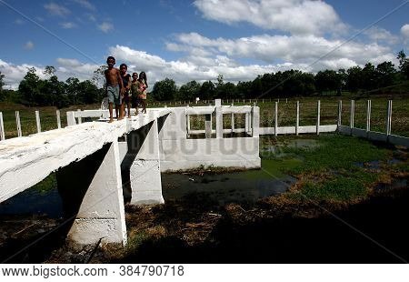 Itabuna, Bahia / Brazil - March 2, 2012: Children Are Seen Playing Around The Sewage Treatment Stati