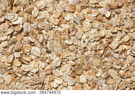 Oat Flakes Background. Large Oatmeal Flakes Top View. Raw Dry Oatmeal For Breakfast