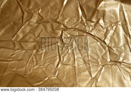 Crumpled Goldcolored Paper. Background Golden From Paper Top View. Crumpled Surface Of Brown Paper T